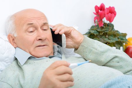 Despondent weary aged man calls up his relatives.