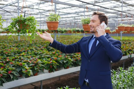 Pleasant greenhouse owner controlling his business