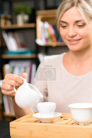 Tea drinking among books