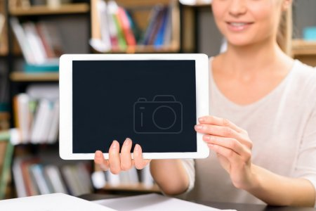 woman is showing her portable tablet.