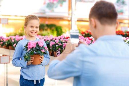 Little girl posing with flower.