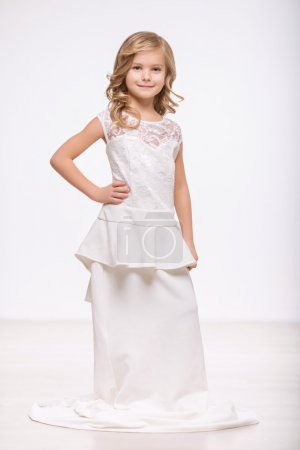 Pleasant little girl in a wedding dress
