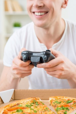 Positive man playing video game