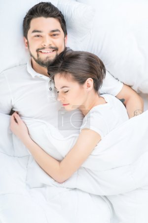 Nice loving couple lying in bed