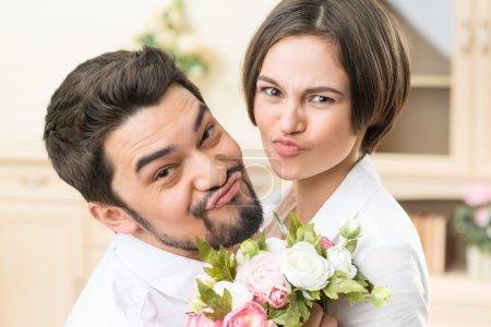 Nice couple grimacing