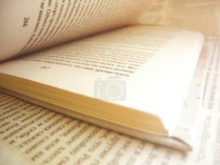 Photo pour Opened book closeup background - image libre de droit