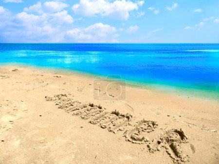 sandy beach with Summer word