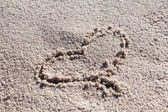 Heart sign on sand