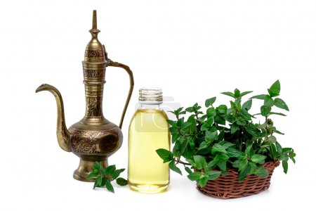 Spa and wellness setting with mint, oil essence and vintage indian pitcher