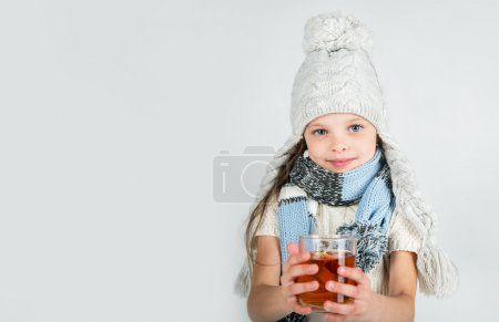 Beautiful Happy Smiling Winter Girl with Tea Mug.