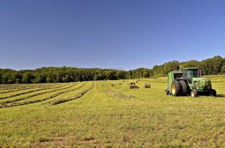 John Deere Baler in alfalfa field