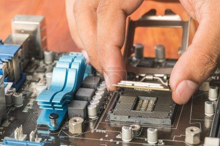 Plug technicians microprocessor motherboard CPU socket.