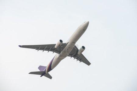 plane flying into sky