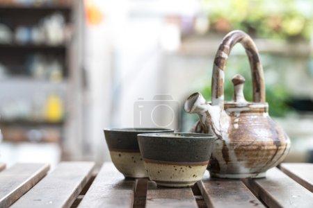 Brown ceramic teapot.