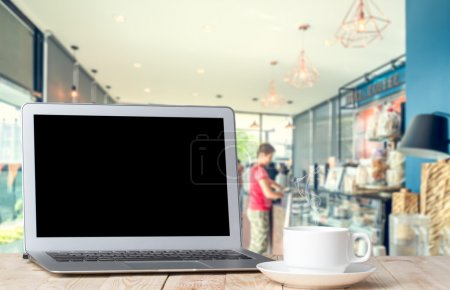 laptop with black screen against blurred coffeshop