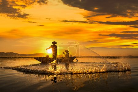 Photo for Fisherman of Bangpra Lake in action when fishing, Thailand - Royalty Free Image