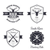 Hunting club vintage logo badges signs emblems with crossed rifles guns deer head on white vector illustration