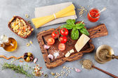 "Постер, картина, фотообои ""Italian food background with vine tomatoes, basil, spaghetti, olives, parmesan, olive oil, garlic"""
