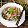 Traditional Vietnamese beef soup photo on a wooden background