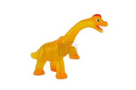 Yellow dinosaur toy figure model isolated on white.