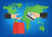 Businessman holding shopping bag and credit card for online shop payment