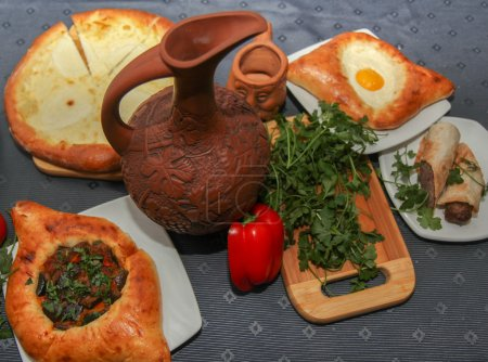 Khachapuri by Adzharia (Georgian cheese pastry), filled with cheese and topped with a soft-boiled egg and butter