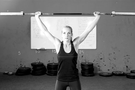 woman doing bar lifting exercises - crossfit workout