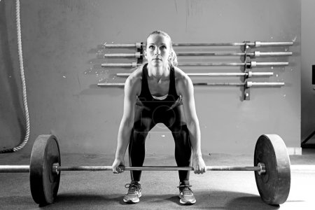 young woman on a weightlifting session - crossfit workou