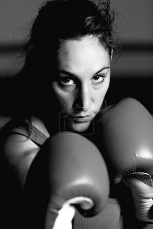 Black and white portrait of female athlete looking at camera