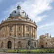 Постер, плакат: Oxford UK August 27 2014: view of the Radcliffe Camera with All Souls College in Oxford UK The historic building is part of Oxford University Library