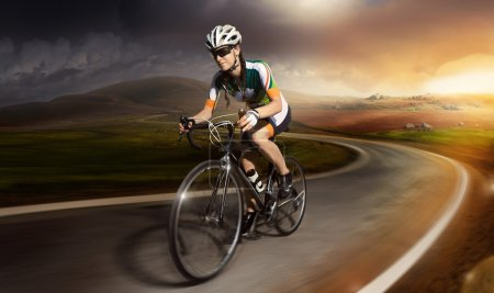 Photo for Mountain Bike cyclist riding track over sunset - Royalty Free Image