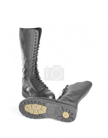 New knee high lace up black combat boots with the sole visible