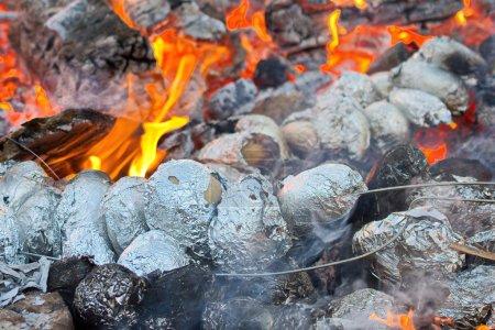 Potatoes baking in a bonfire