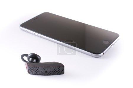 Modern wireless Jawbone bluetooth headset with an iPhone