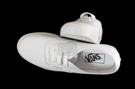 White Vans sneakers isolated on black