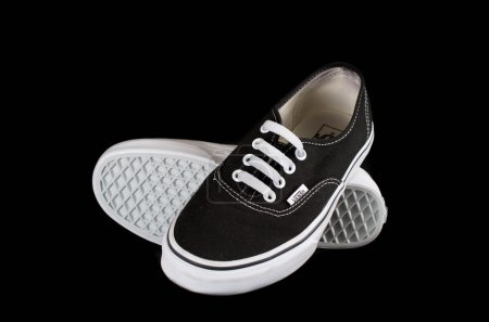 Black Vans sneakers isolated on black