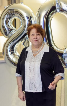 Woman celebrating 80th Birthday
