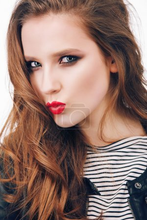 girl with bright make-up  shows kiss