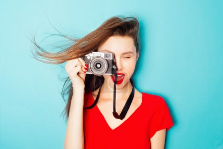 brunette woman  with a camera