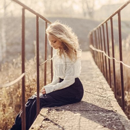 Photo for Portrait of a beautiful young blond woman on the bridge, happy mood, life style - Royalty Free Image