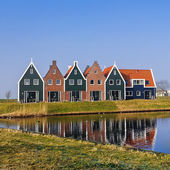 Colored houses of marine  park in Volendam reflected in