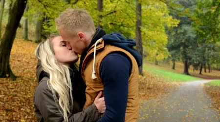 Young model happy couple in love - couple kiss - autumn park (nature)