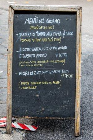 a restaurant menu written on a blackboard
