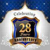 Celebrating 28 years anniversary Golden sheild with blue royal emblem background - vector eps10