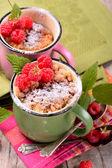 Warm chocolate cake in a mug sprinkled with icing sugar
