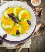 Appetizer of avocado and orange