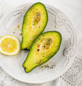 avocado halves with butter salt and pepper