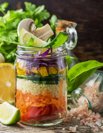 Fresh colorful salad in the jar