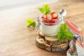 Homemade strawberry yogurt with fresh wild strawberries