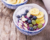 Breakfast smoothie bowl with fruits and granola